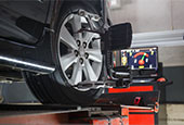 $30 off four wheel alignment special with adjustment